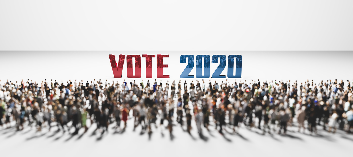 Vote 2020 slogan in front of large group of people.